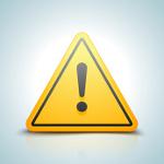 Gelbes Dreieck-Schild mit schwarzem Warnzeichen